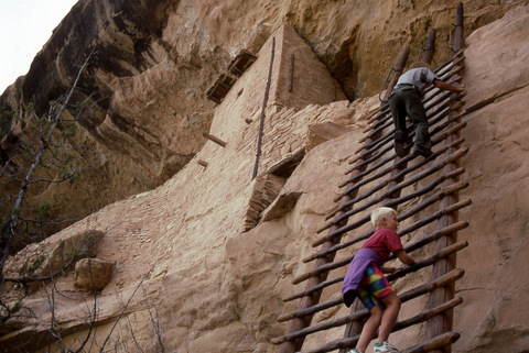 A park ranger leads a tour to Balcony House, Mesa Verde National Park, Colorado