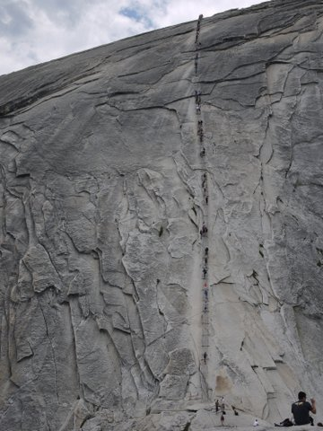 Climbers on cables at Half Dome, Yosemite National Park, California