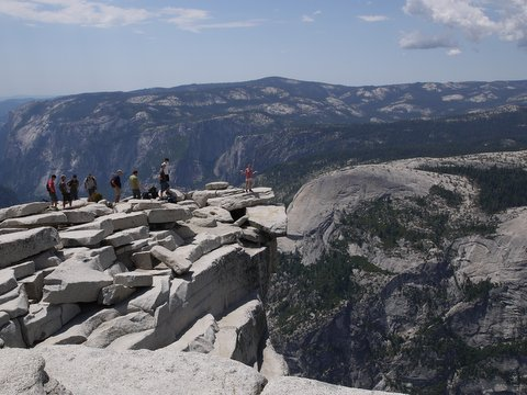 Julie on visor of Half Dome, Yosemite National Park, California
