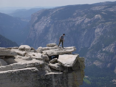 Posing on visor of Half Dome, Yosemite National Park, California