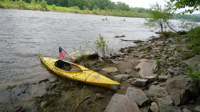 Kayak beached beside Delaware River
