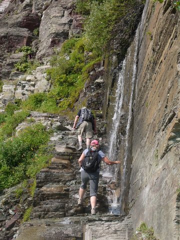Cold water sprays on hikers, Grinnell Glacier Trail, Glacier National Park, Montana