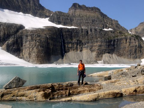 Charlie Posing in Front of Upper Grinnell Lake, with Salamander Glacier Overhead; Glacier National Park, Montana