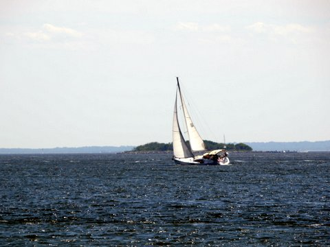 Sailboat passing east of Hoffman Island, Lower New York Bay, New York