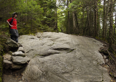 Batya admires a flat rock, Camel's Hump State Park, Chittenden & Washington Counties, Vermont